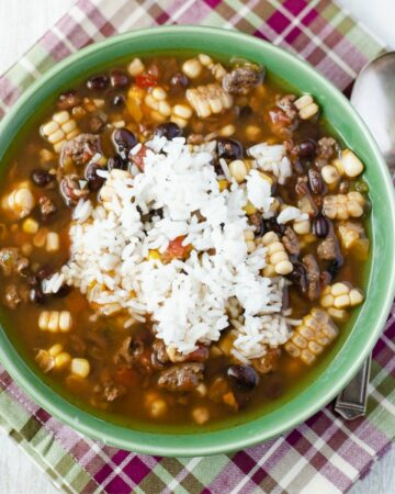 Black Bean and corn soup in a soup bowl on top of a napkin.