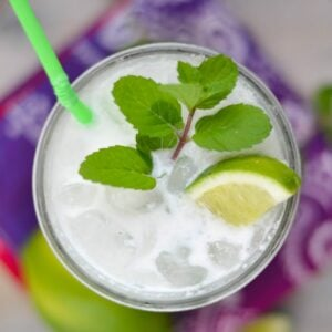 Coconut Mojito in a glass with mint and lime wedge.