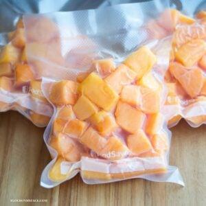 Cubed papaya in freezer bags.