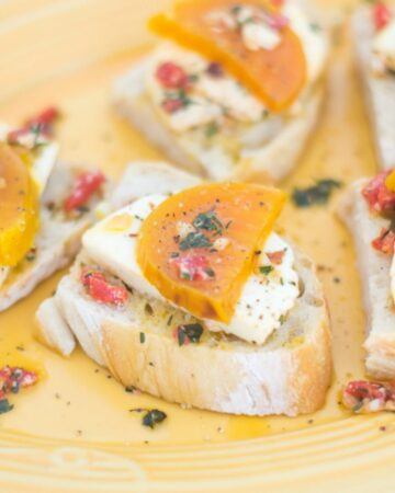 Golden Beet Crostini on a yellow plate.