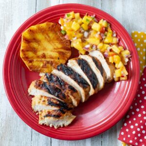 Key lime grilled chicken with sides on a plate.