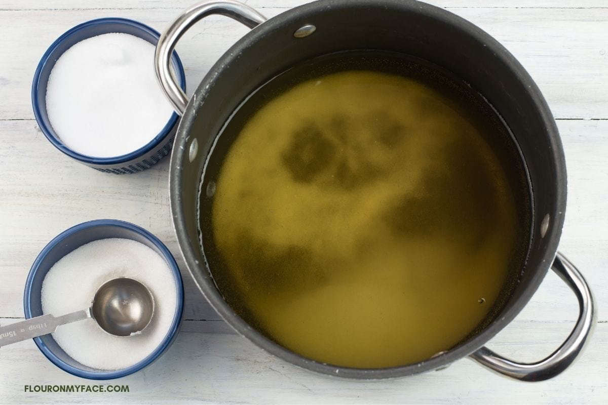 Mixing pickling brine ingredients in a pot.