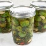 Pickled green cherry tomatoes.