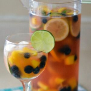 Pink Moscato Sangria in a tall pitcher with a filled glass.