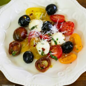 Overhead of a salad plate with a serving of tomato salad.
