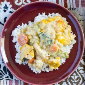 Crock Pot Chicken and Vegetables served over rice.