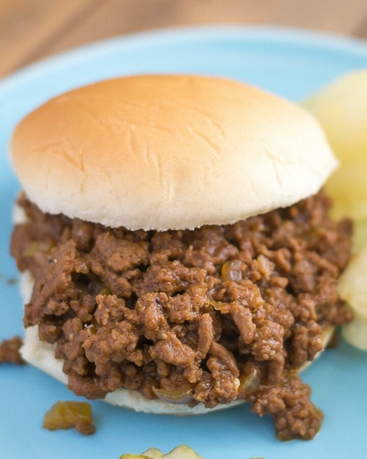 Crock Pot Sloppy Joes on a plate served with chips.