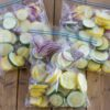 Sliced squash in freezer bags.