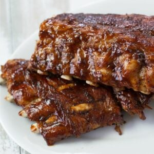 Two racks of Instant Pot Baby Back Ribs on a serving platter.