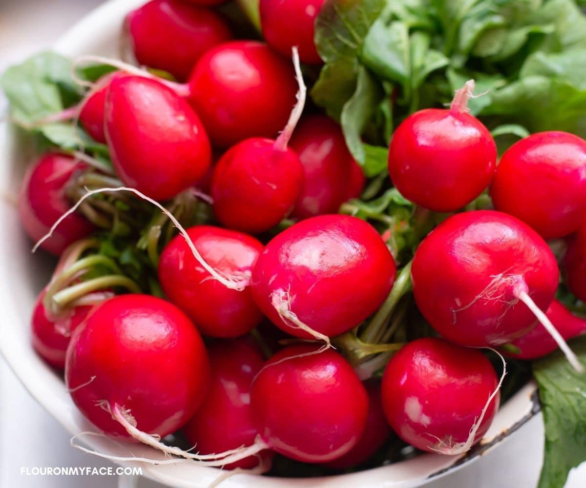 Fresh radishes in a colander.