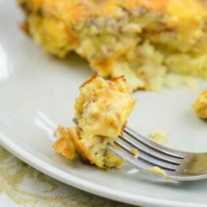 A closeup of a forkful of cheesy Velveeta Breakfast Casserole.