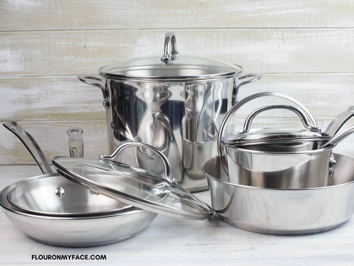 Photo of the Farberware 10 piece Millennium stainless steel cookware set on a table top.