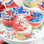 Red white and blue 4th of July Cupcakes on a cake stand.
