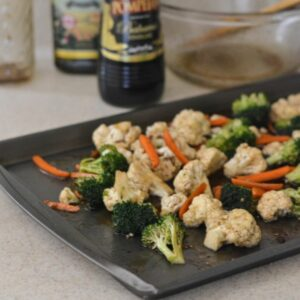 Balsamic Vegetable Medley on a cookie sheet before roasting.