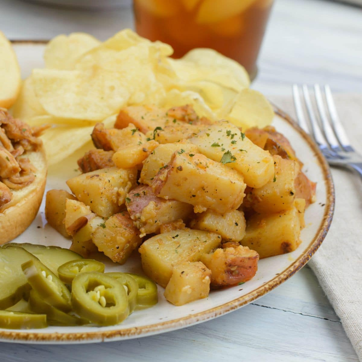Closeup of a serving of garlic potatoes on a dinner plate.