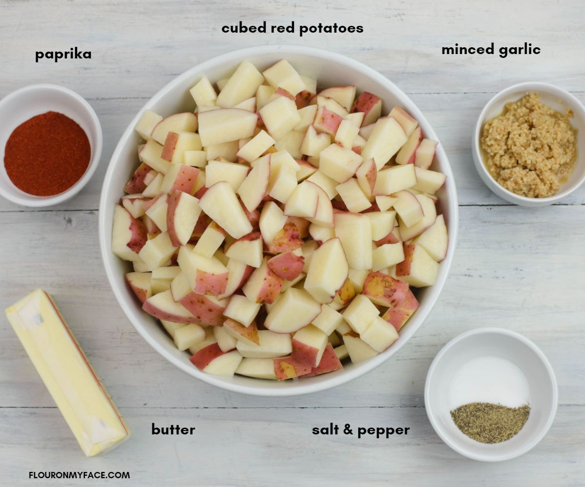 Individual bowls with the ingredients needed to make garlic potatoes.