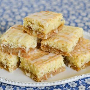 Peach bars piled up on a serving plate.