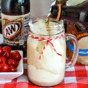 Pouring root beer into a glass filled with ice cream to make a float.