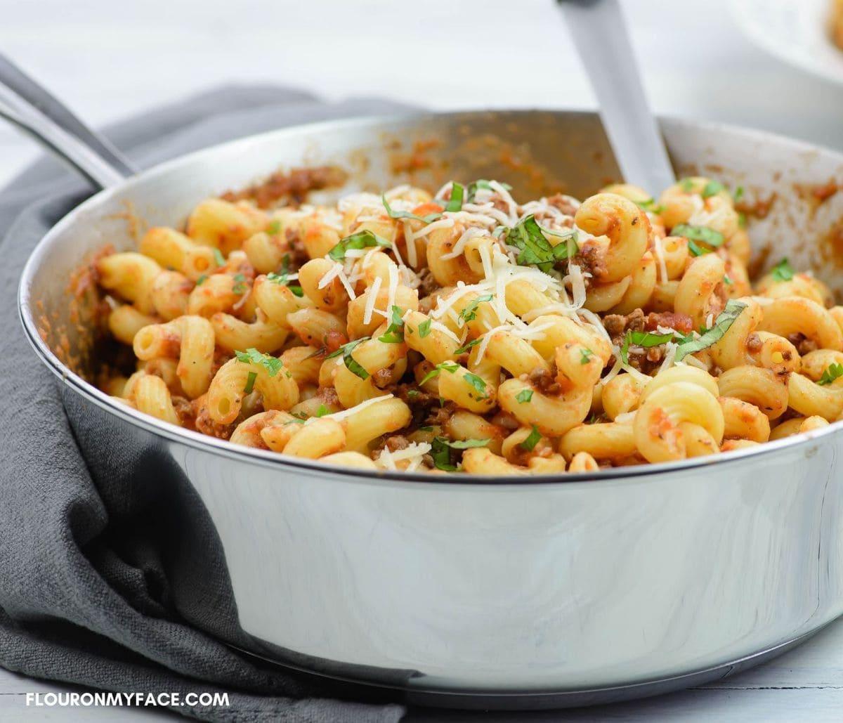 Serving skillet pasta from a deep skillet.