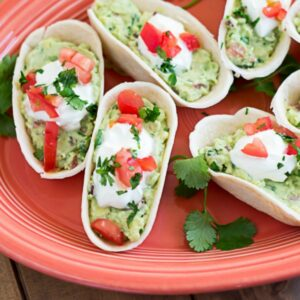 Mini Guacamole Boats appetizers on a serving platter.