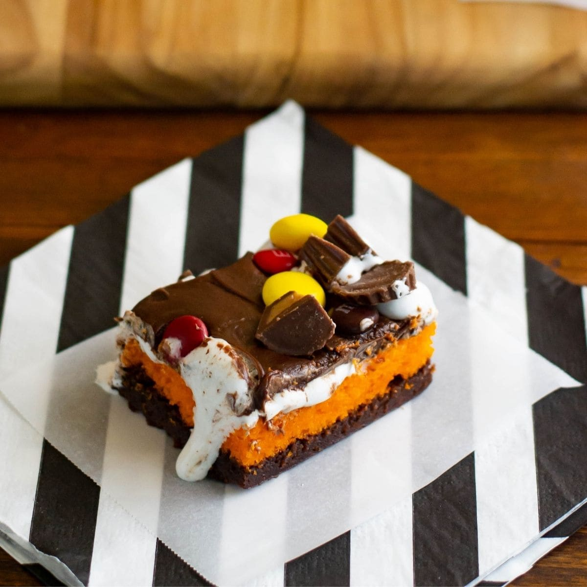 Halloween Brownie Cake bars on a black and white napkin.